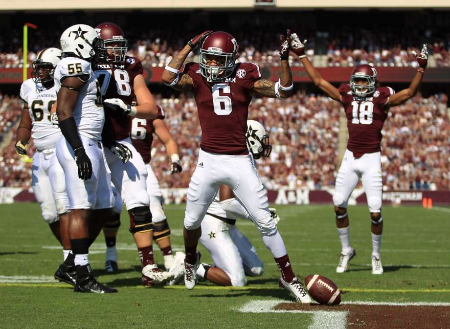 Texas A&M's LaQuvionte Gonzales (6) celebrates his touchdown during the first half of an NCAA football game against Vanderbilt, Saturday, Oct. 26, 2013, in College Station, Texas. Photo: Eric Christian Smith, Associated Press