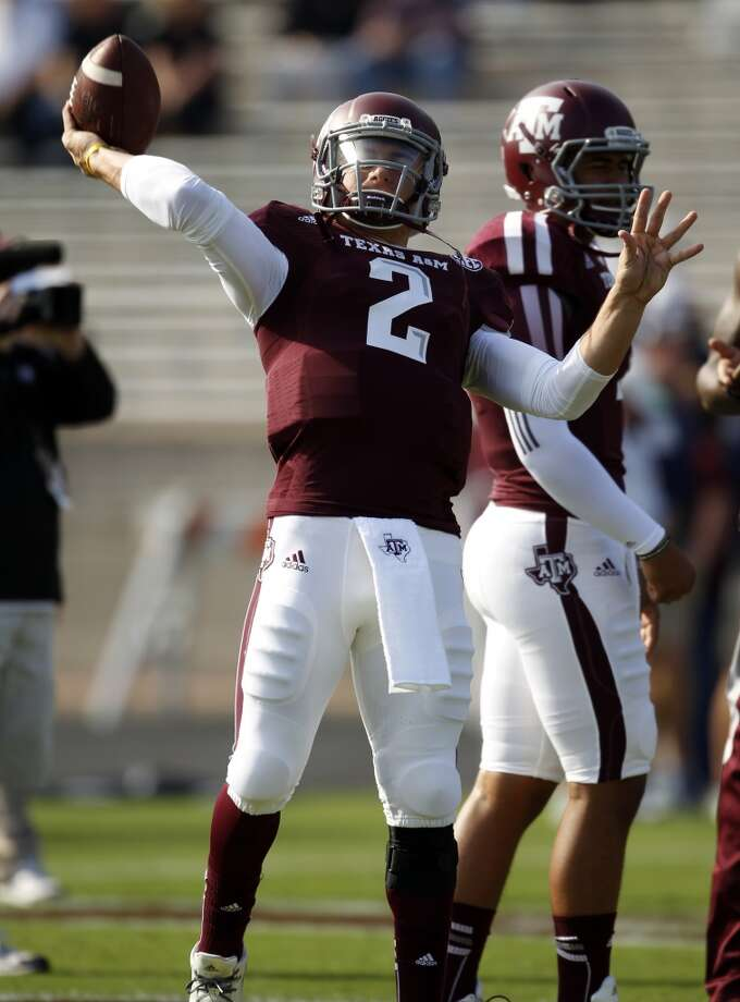 Texas A&M's Johnny Manziel warms up before an NCAA football game against Vanderbilt, Saturday, Oct. 26, 2013, in College Station, Texas. Photo: Eric Christian Smith, Associated Press
