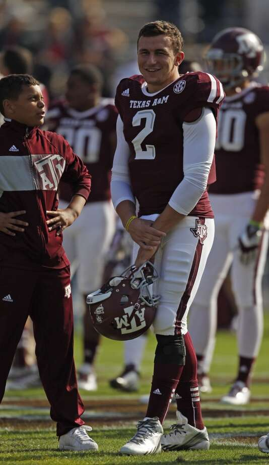 Texas A&M's Johnny Manziel looks on during warm ups before an NCAA football game against Vanderbilt, Saturday, Oct. 26, 2013 in College Station, TX. Photo: Eric Christian Smith, Associated Press