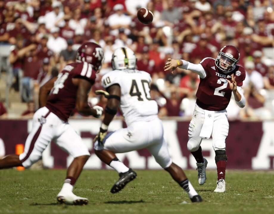 Texas A&M's Johnny Manziel (2) throws a pass during the first half of an NCAA football game against Vanderbilt, Saturday, Oct. 26, 2013, in College Station, Texas. Photo: Eric Christian Smith, Associated Press