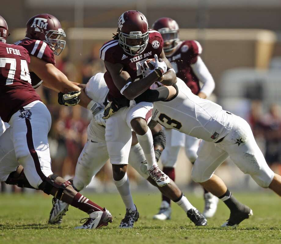 Texas A&M's Brandon Williams, center, is tackled by Vanderbilt's Jake Sealand during the second half of an NCAA college football game, Saturday, Oct. 26, 2013, in College Station, Texas. Photo: Eric Christian Smith, Associated Press