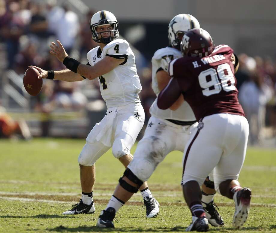 Vanderbilt's Patton Robinette drops back to pass during the second half of an NCAA football game against Texas A&M, Saturday, Oct. 26, 2013, in College Station, Texas. Photo: Eric Christian Smith, Associated Press