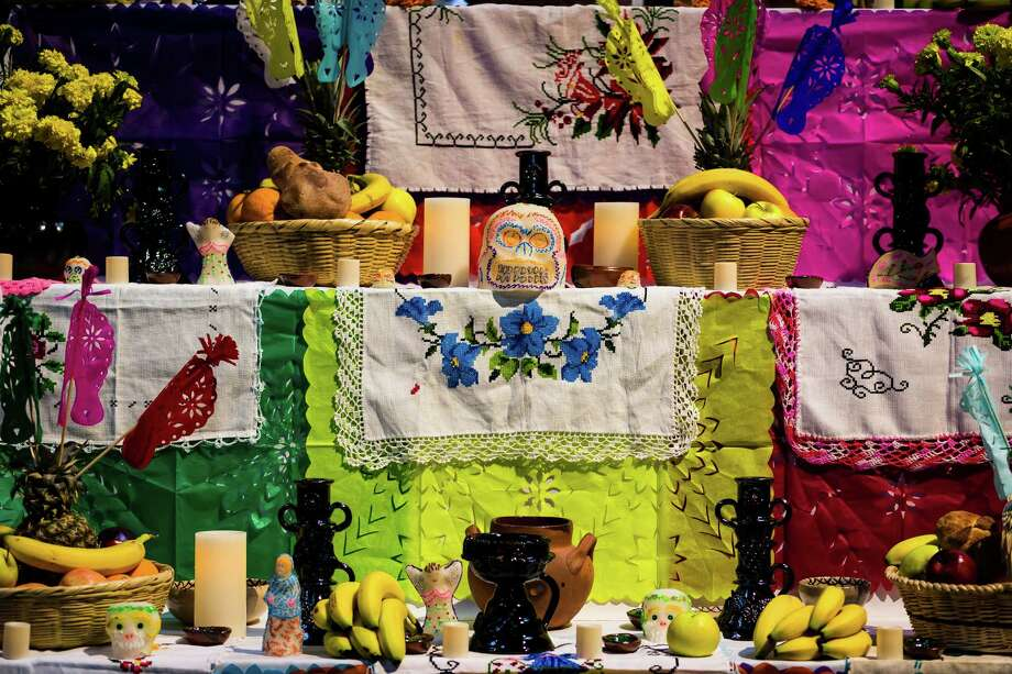"""A display of offerings at the Dia De Los Muertos """"A Mexican Celebration to Remember Our Departed"""" event Saturday, Oct. 26, 2013, in The Armory in the Seattle Center in Seattle. The festival honors the lives of loved ones who have passed with homage from community altars, sugar skulls, special food, candles, music and dance. The event continues Sunday. Photo: JORDAN STEAD, SEATTLEPI.COM / SEATTLEPI.COM"""