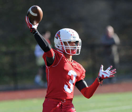 Austin Longi (# 3) of Greenwich throws a touchdown pass to Devin McGrath during the fi