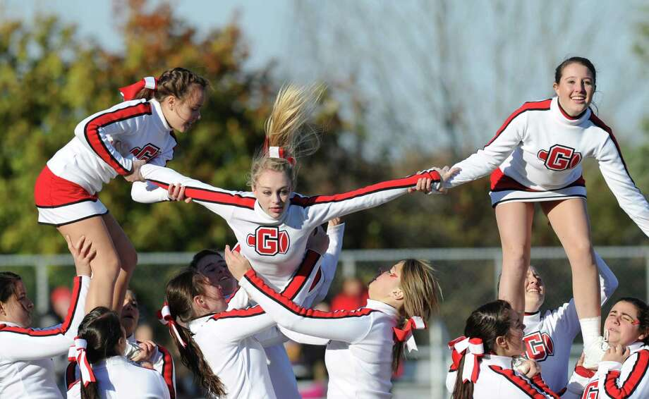 The Greenwich High School cheerleaders perform as part of the Homecoming activities during halftime of the football game between Greenwich and Fairfield Warde High School at Greenwich, Saturday, Oct. 26, 2013. Photo: Bob Luckey / Greenwich Time