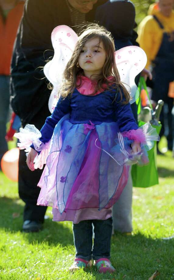 Claire Anderlot, 3 1/2, of Danbury attends the 21st annual Halloween on the Green in Danbury, Conn, on Saturday October 26, 2013. She is dressed as a Fairy. Photo: H John Voorhees III / The News-Times Freelance