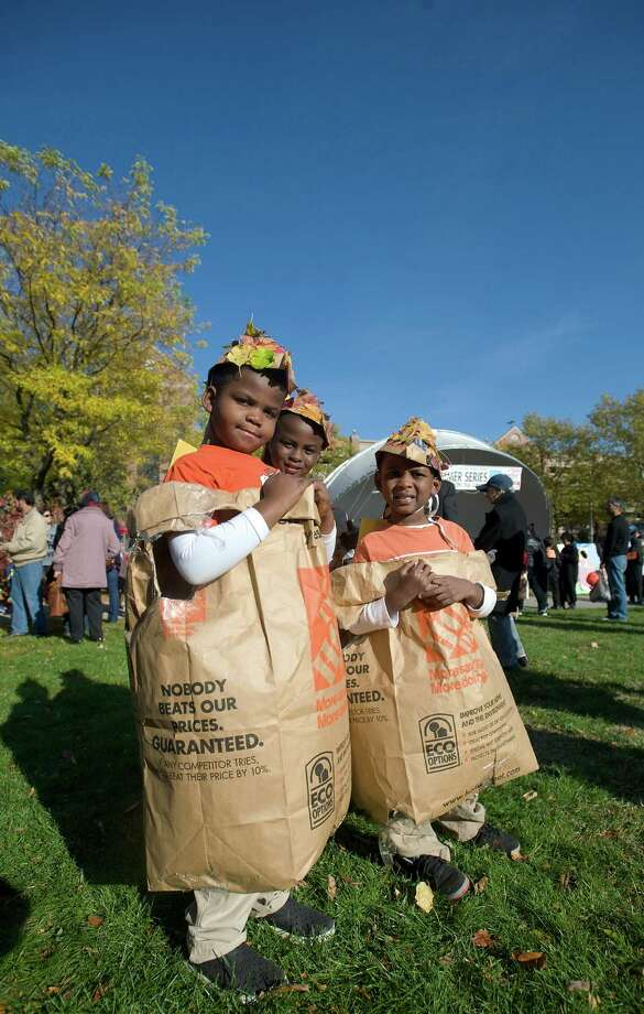 Kayden Riley, left, 7, of Danbury , and his cousins  Justin Southwell, 5, on right, and Rudy Southwell, 7, from  New Rochelle, NY, attend the 21st annual Halloween on the Green in Danbury, Conn, on Saturday October 26, 2013. They were all dressed as Leaf Bags Photo: H John Voorhees III / The News-Times Freelance