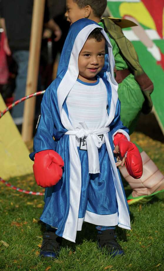 Jalen Uribe,2, dressed as a boxer for the 21st annual Halloween on the Green in Danbury, Conn, on Saturday October 26, 2013. Photo: H John Voorhees III / The News-Times Freelance
