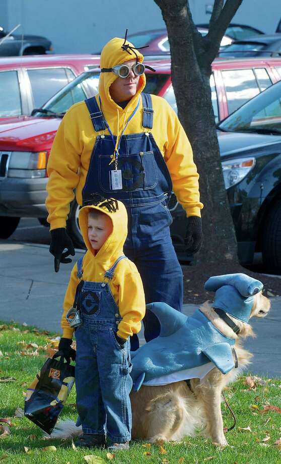 Joshua Palkewick, 5,  and his dad Nate Palkewick, from New Fairfield, came dressed as Minions from the Despicable Me movies, to the 21st annual Halloween on the Green in Danbury, Conn, on Saturday October 26, 2013. Photo: H John Voorhees III / The News-Times Freelance