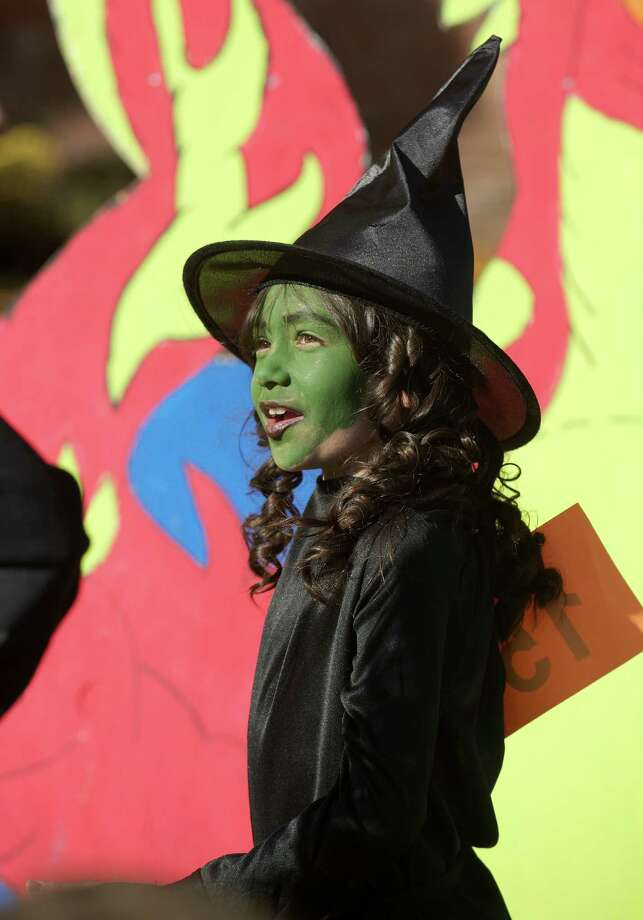 Julesa Cruz, 8, of Danbury, is dressed as a Green Faced Witch at the 21st annual Halloween on the Green in Danbury, Conn, on Saturday October 26, 2013. Photo: H John Voorhees III / The News-Times Freelance