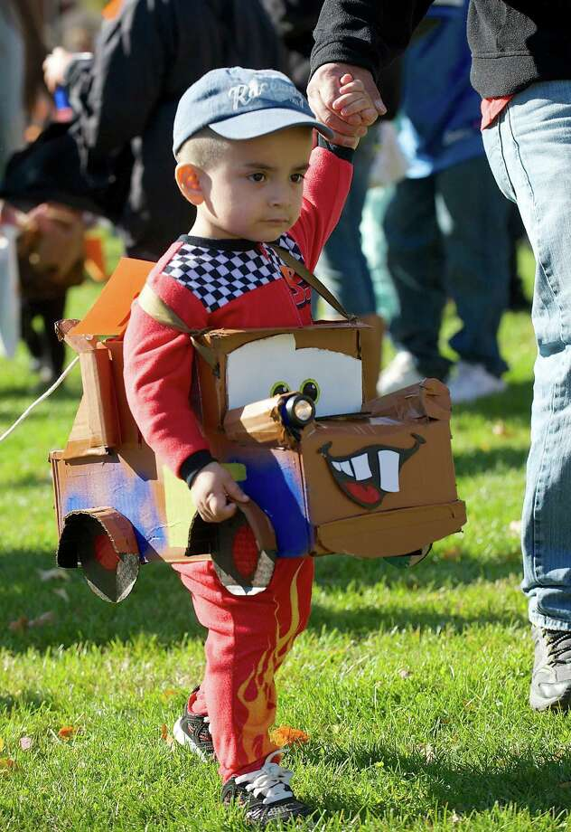 "Matthews Leon, 2, of Danbury, is dressed as ""Mater"" a tow truck from the movie Cars at the 21st annual Halloween on the Green in Danbury, Conn, on Saturday October 26, 2013. Leon's Dad made the costume for him. Photo: H John Voorhees III / The News-Times Freelance"