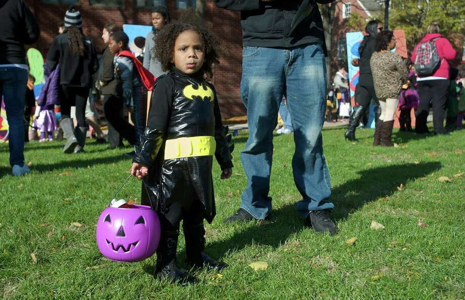 Natalie Pierre, 2 1/2, from New Haven, came dressed as Batman to the 21st annual Halloween on the Green in Danbury, Conn, on Saturday October 26, 2013. Photo: H John Voorhees III / The News-Times Freelance