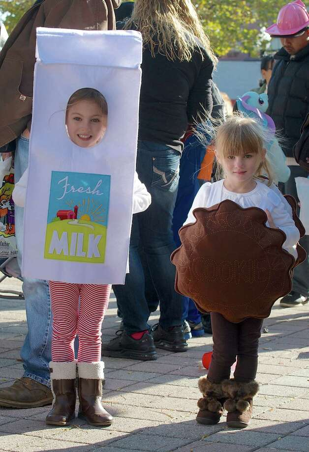 Emma Wohlrab, 5, of Danbury, left, and her sister Claudia Wohlrab, 3, attended the 21st annual Halloween on the Green in Danbury, Conn, on Saturday October 26, 2013. Emma was dressed as Milk and Claudia as a Cookie. Photo: H John Voorhees III / The News-Times Freelance