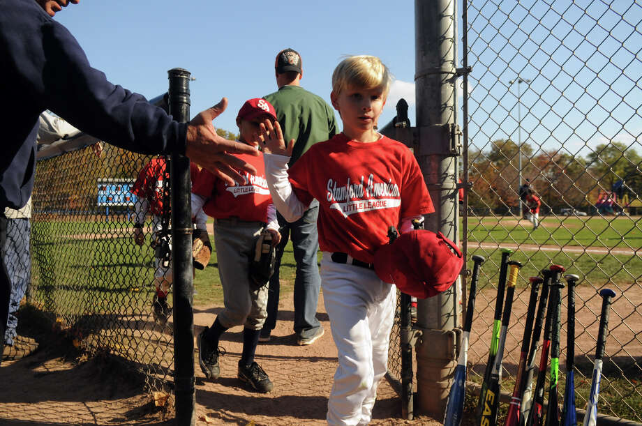 The Stamford American Little League team plays what might be its last game at Springdale School in Stamford, Conn., Oct. 26, 2013. The team is hoping the Parks and Recreation Board intervenes in a dispute with the league's board over a merger with the North Stamford Little League. Photo: Keelin Daly / Stamford Advocate Freelance