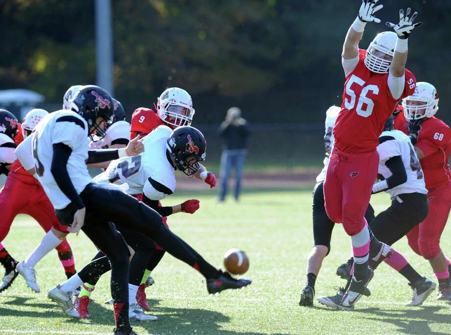 High school football game between Greenwich High School and Fairfield Warde High School at Greenwich, Saturday, Oct. 26, 2013. Greenwich defeated Warde, 42-7. Photo: Bob Luckey / Greenwich Time