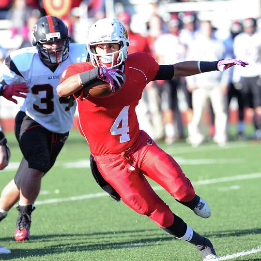Jose Melo (# 4) of Greenwich gets past Max Snapper (# 34) of Fairfield Warde during the high school