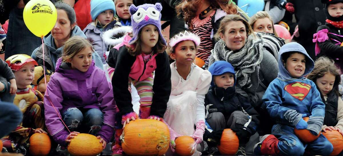 Costume-clad children wait for the start of a pumpkin roll down Caroline Street during the Saratoga Springs Fall Festival on Saturday, Oct. 26, 2013, in Saratoga Springs, N.Y. The event featured family entertainment, face painting, games and a costume parade. (Cindy Schultz / Times Union)