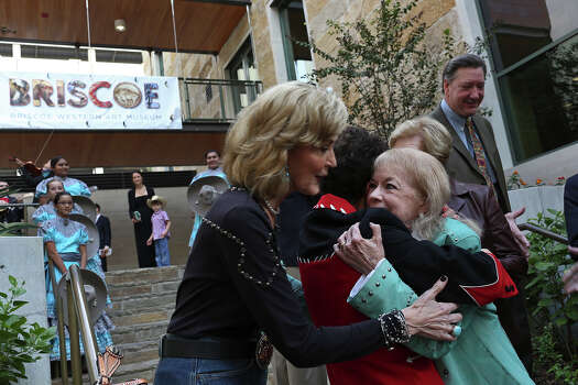 Tracy Wolff, from left, embraces Debbie Montford, and Janey Briscoe Marmion, the daughter of Dolph Briscoe, after the ribbon cutting during the grand opening celebration for the Briscoe Western Art Museum in San Antonio on Saturday, Oct. 26, 2013. Photo: Lisa Krantz, San Antonio Express-News / San Antonio Express-News