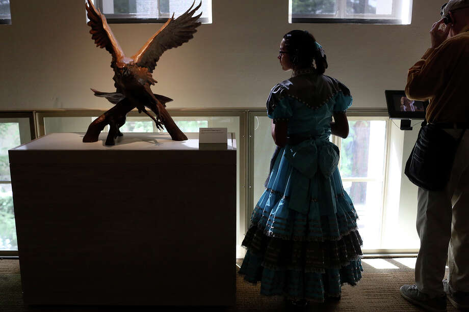 Caterina Parafina, 12, a member of the Las Espuelas Escaramuza Team tours the museum after performing during the grand opening celebration for the Briscoe Western Art Museum in San Antonio on Saturday, Oct. 26, 2013. Photo: Lisa Krantz, San Antonio Express-News / San Antonio Express-News