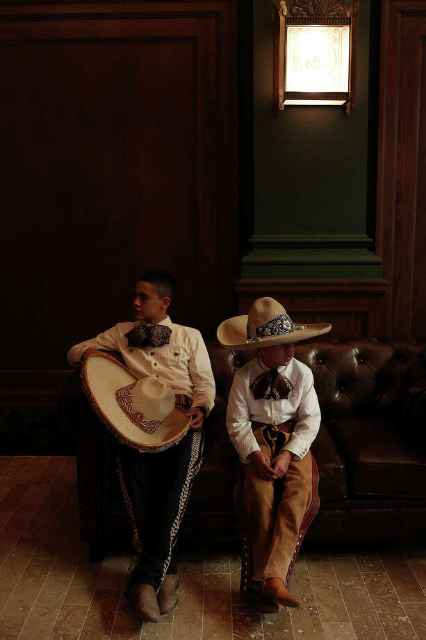 Edmundo Rios III, 17, and Diego Rivera, 8, rest inside the Briscoe Western Art Museum after performing with the San Antonio Charro Association during the grand opening celebration for the museum in San Antonio on Saturday, Oct. 26, 2013. Photo: Lisa Krantz, San Antonio Express-News / San Antonio Express-News