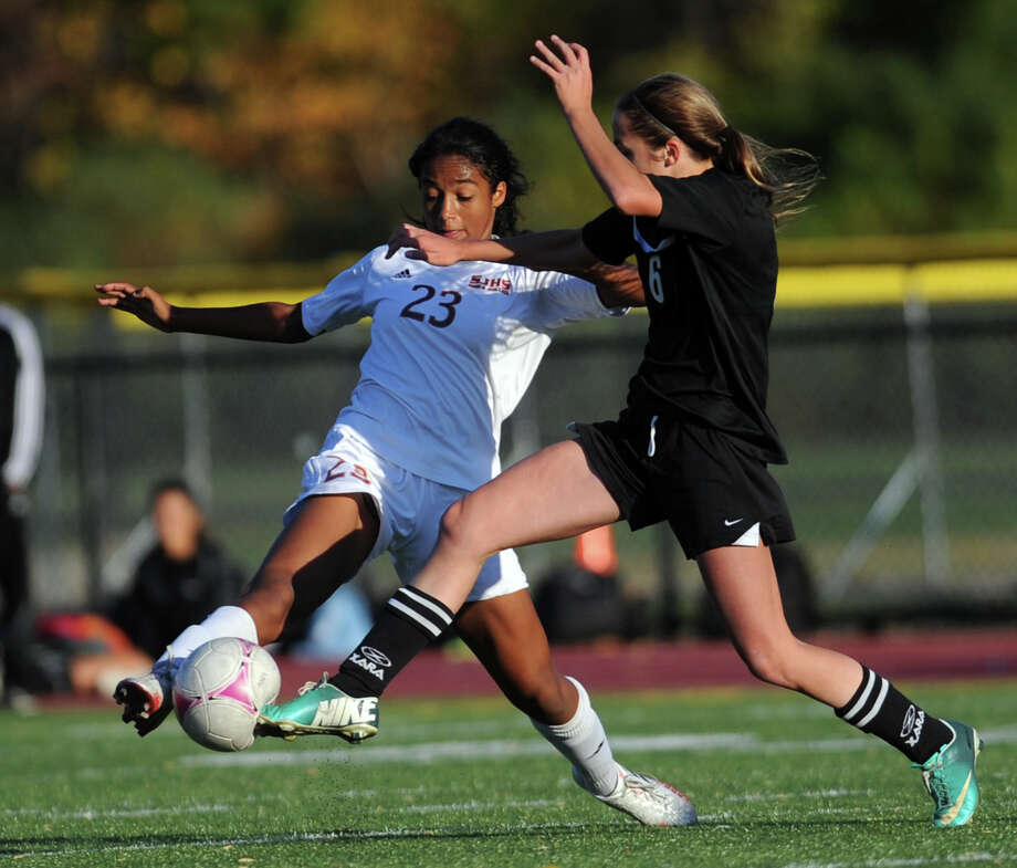 St. Joseph's Leah Lewis and Trumbull's Kyriaki Marinos battle for the ball during the FCIAC girls soccer playoffs Saturday, Oct. 26, 2013 at St. Joseph High School in Trumbull, Conn. Photo: Autumn Driscoll / Connecticut Post