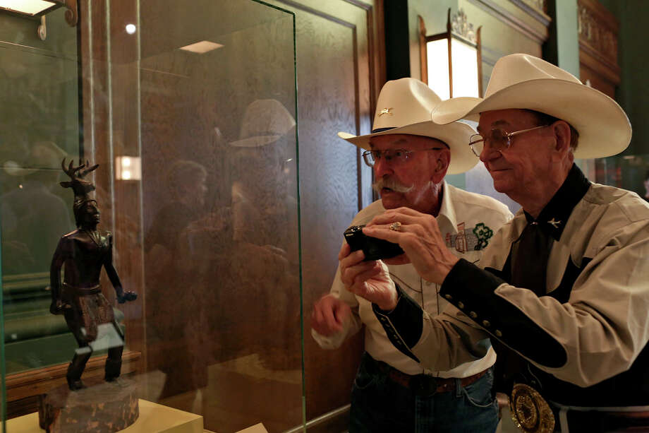 "Bill ""Wild Bill"" Petre, 87, left, and Jack ""Cowboy Jack"" Williams, 84, both residents of Air Force Retirement Village I, look at a Yaqui Deer Dancer during the grand opening celebration for the Briscoe Western Art Museum in San Antonio on Saturday, Oct. 26, 2013. Petre is an Army veteran who served in World War II and Korea and Williams is an Air Force Veteran who served in Vietnam and Korea. Photo: Lisa Krantz, San Antonio Express-News / San Antonio Express-News"