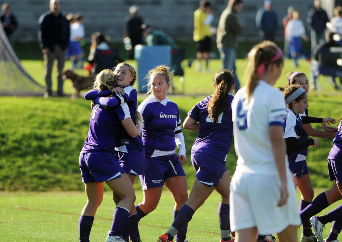 Westhill celebrates a goal as Darien High School hosts Westhill in a girls soccer game in Darien, Conn., Oct. 26, 2013.