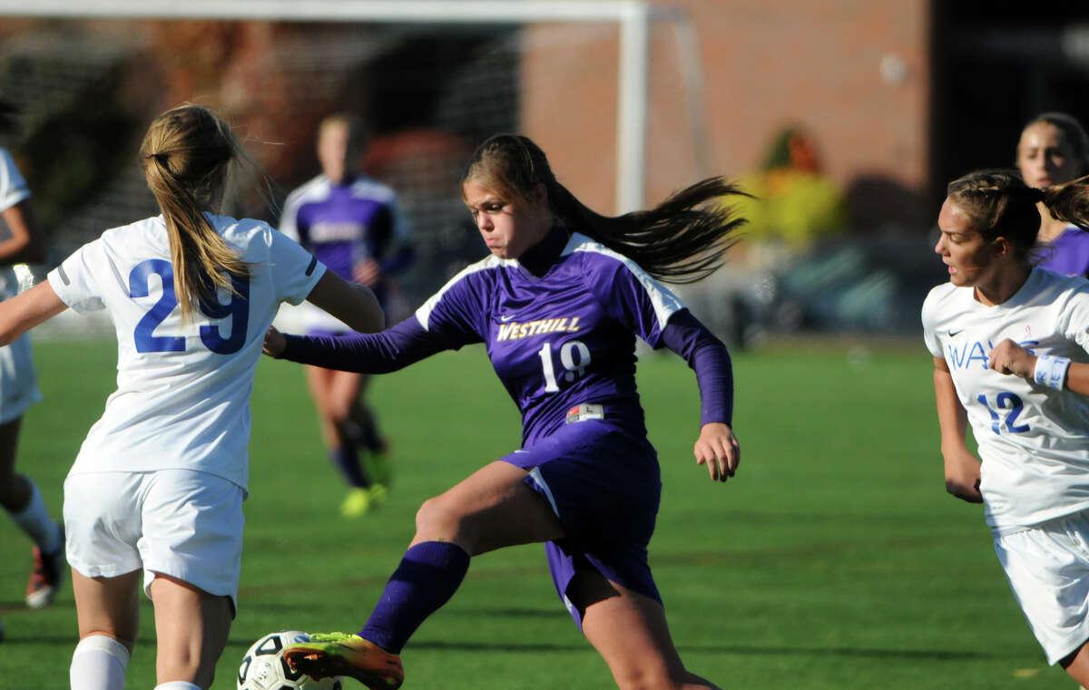 Westhill's Jess Laszlo weaves through the Darien defense as Darien High School hosts Westhill in a girls soccer game in Darien, Conn., Oct. 26, 2013.