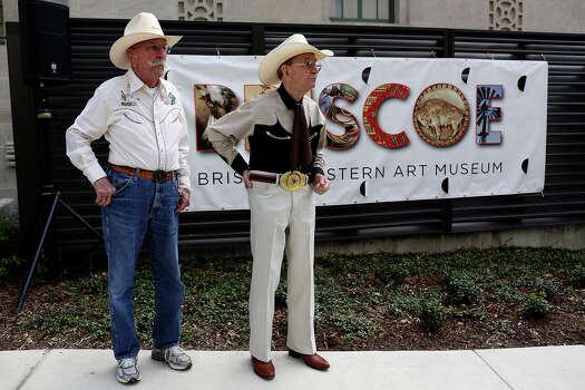 "Bill ""Wild Bill"" Petre, 87, left, and Jack ""Cowboy Jack"" Williams, 84, both residents of Air Force Retirement Village I, watch Mariachi Fiesta de San Antonio perform during the grand opening celebration for the Briscoe Western Art Museum in San Antonio on Saturday, Oct. 26, 2013. Petre is an Army veteran who served in World War II and Korea and Williams is an Air Force Veteran who served in Vietnam and Korea. Photo: Lisa Krantz, San Antonio Express-News / San Antonio Express-News"