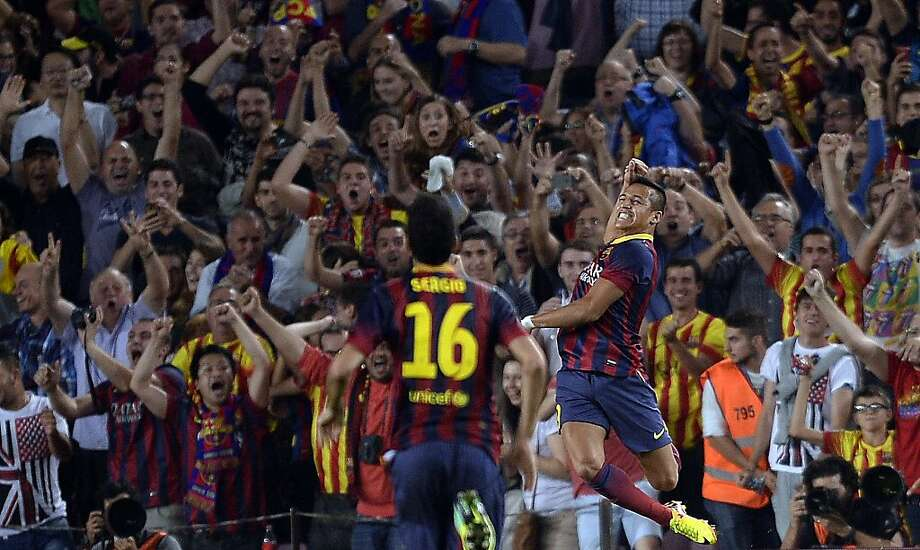 "Barcelona's Alexis Sanchez celebrates his 78th-minute game-winner against Real Madrid during a ""clasico"" match in Barcelona. Photo: Manu Fernandez, Associated Press"