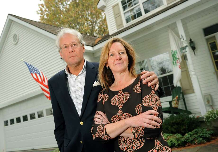 Dan Lundquist and his wife Beth Post-Lundquist on Saturday, Oct. 26, 2013, at their home in Saratoga Springs, N.Y. (Cindy Schultz / Times Union) Photo: Cindy Schultz / 00024404A