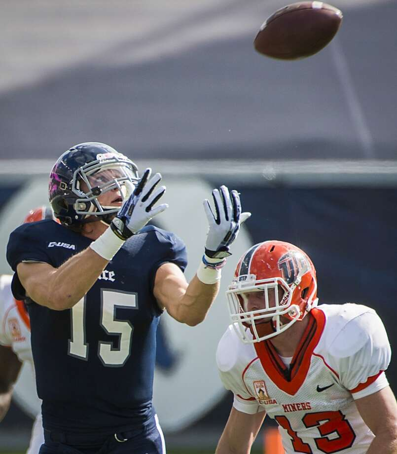 Rice wide receiver Jordan Taylor (15) catches a 60-yard touchdown pass as UTEP defensive back Wesley Miller defends. Photo: Smiley N. Pool, Houston Chronicle