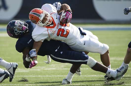 UTEP running back Nathan Jeffery is brought down by Rice safety Julius White. Photo: Smiley N. Pool, Houston Chronicle