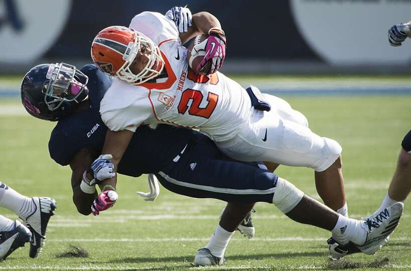 UTEP running back Nathan Jeffery is brought down by Rice safety Julius White.
