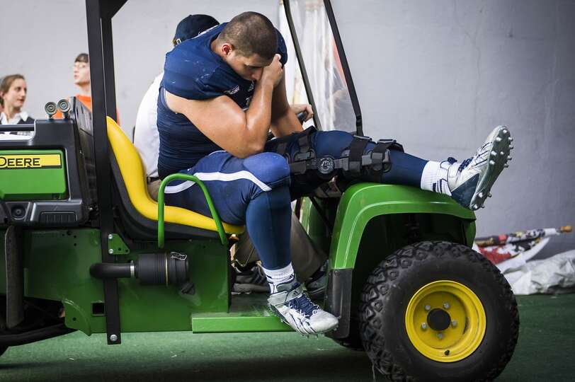Rice defensive lineman Stuart Mouchantaf leaves the game due to an injury during the first half.
