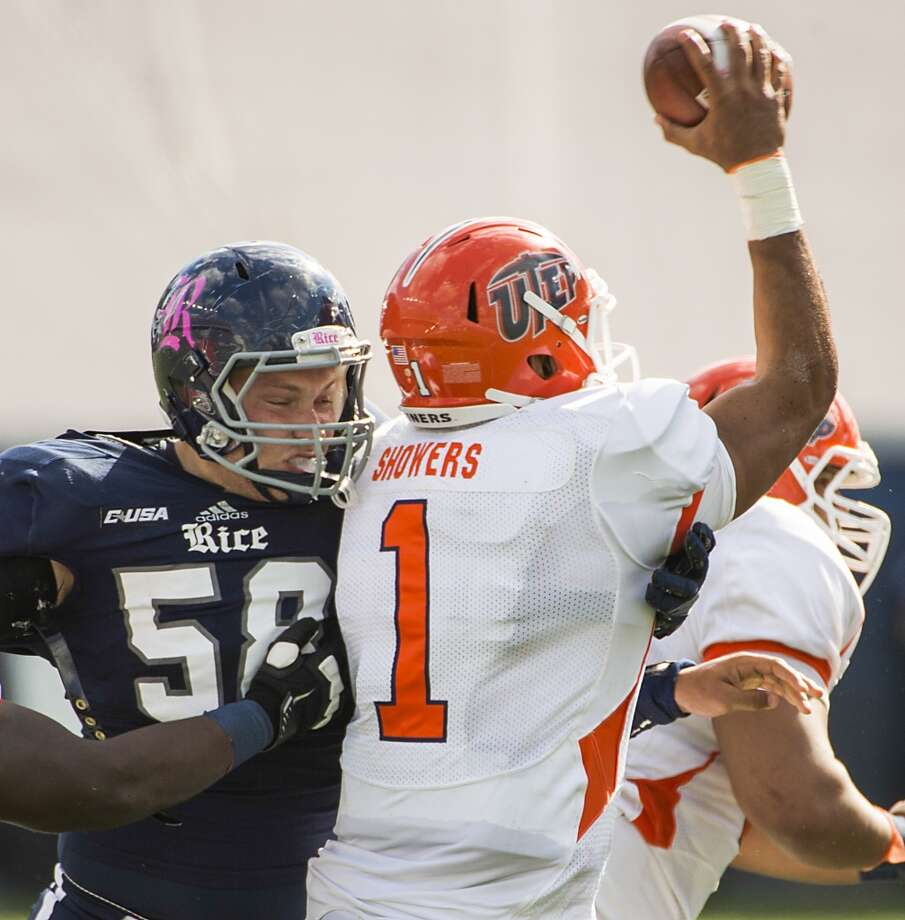 Rice defensive tackle Cody Henessee  hits UTEP quarterback Jameill Showers as he tries to get off a pass during the first half. Showers left the game after the play. Photo: Smiley N. Pool, Houston Chronicle
