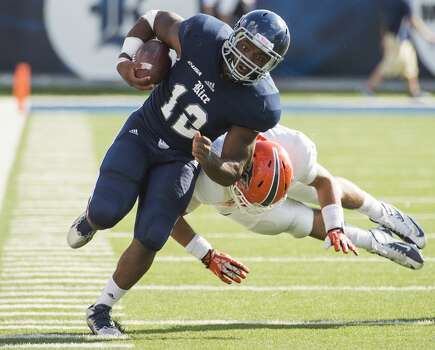 Rice running back Charles Ross is knocked out of bounds by UTEP defensive back Richard Spencer. Photo: Smiley N. Pool, Houston Chronicle