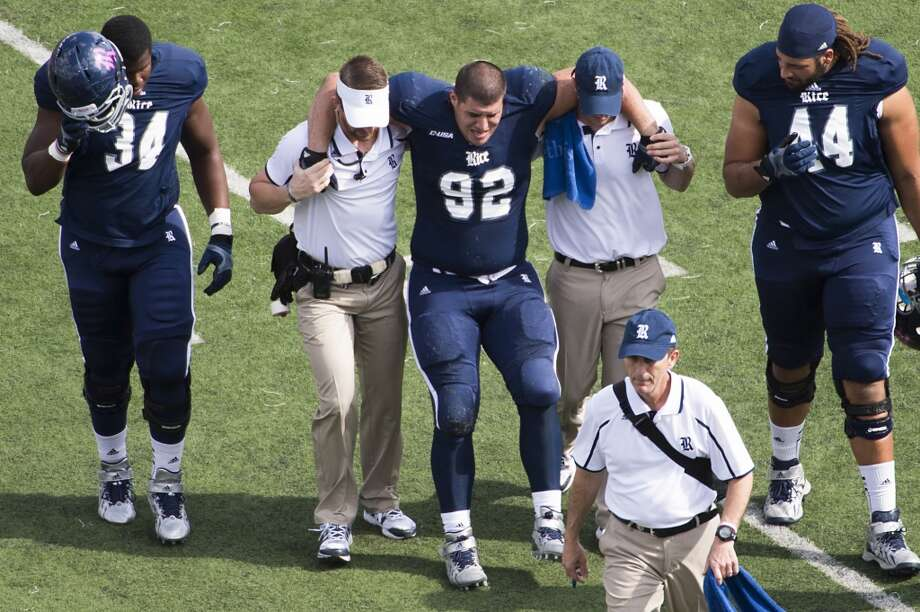 Rice defensive lineman Stuart Mouchantaf leaves the game with an injury. Photo: Smiley N. Pool, Houston Chronicle