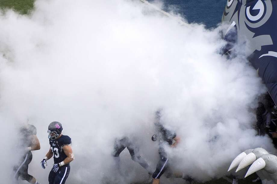 Rice players take the field before a college football game against UTEP at Rice Stadium. Photo: Smiley N. Pool, Houston Chronicle