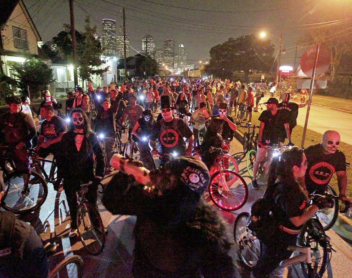 Thousands of bicyclist wait for a train at a railroad crossing on Houston Avenue during the Critical Mass bike ride Friday, Oct. 25, 2013, in Houston. The first to have a police escort.See video from the event at HoustonChronicle.com.