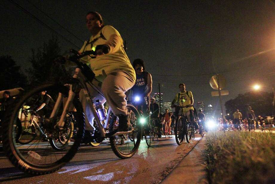 Thousands of bicyclist ride along Houston Avenue during the Critical Mass bike ride Friday, Oct. 25, 2013, in Houston. Photo: James Nielsen, Houston Chronicle / © 2013  Houston Chronicle