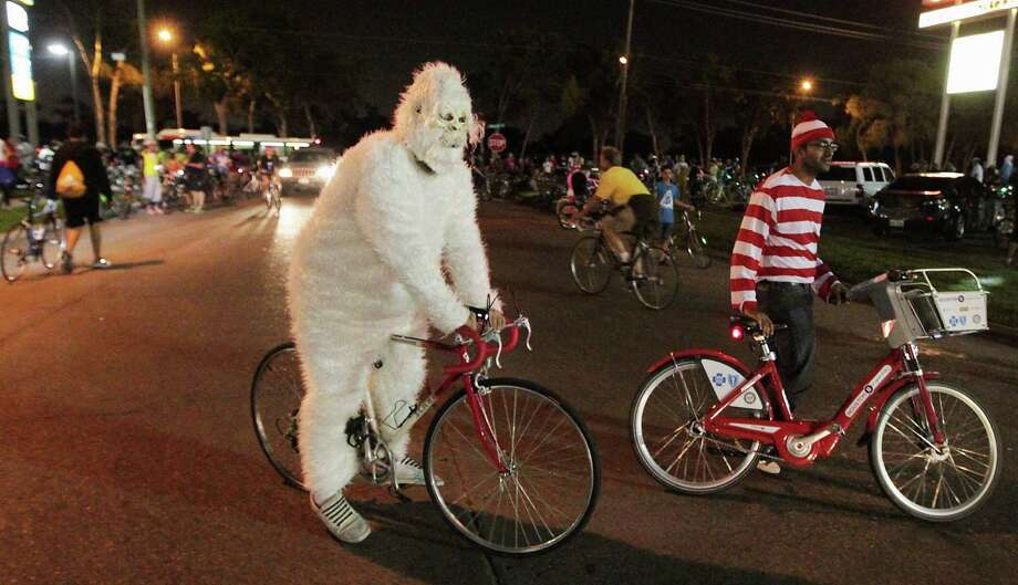 Costumed riders for the halloween Critical Mass bike ride Friday, Oct. 25, 2013, in Houston. Photo: James Nielsen, Houston Chronicle / © 2013  Houston Chronicle