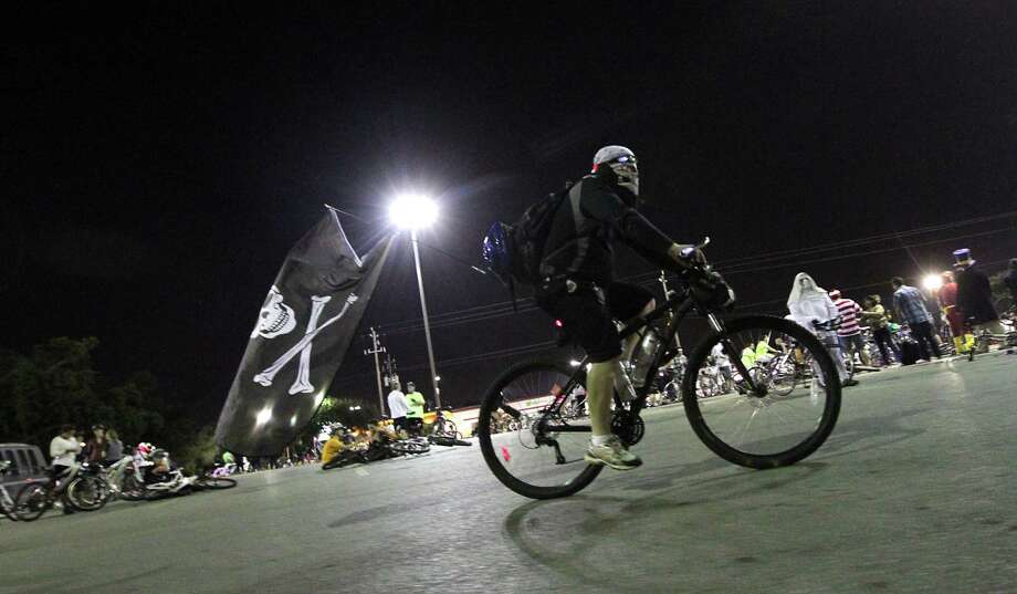 A costumed rider for the halloween Critical Mass bike ride Friday, Oct. 25, 2013, in Houston. Photo: James Nielsen, Houston Chronicle / © 2013  Houston Chronicle