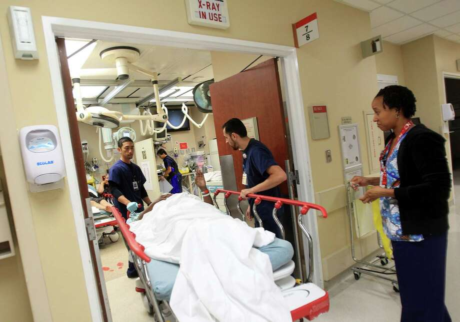 A 1986 federal law requires hospital emergency rooms to treat all who seek care, whether or not they can pay. Photo: Mayra Beltran, Staff / © 2013 Houston Chronicle