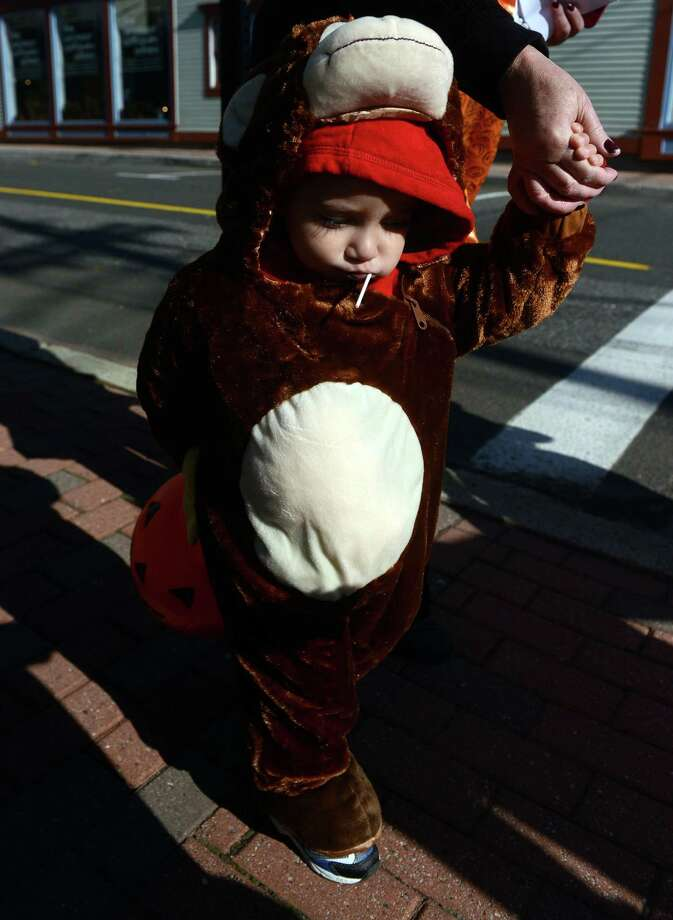 Children visit downtown businesses Saturday, Oct. 26, 2013 during the 7th annual Seymour Trick or Treat Day. Photo: Autumn Driscoll / Connecticut Post