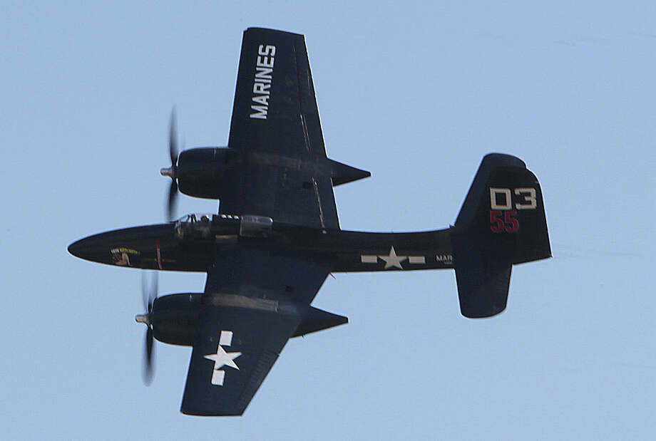 A F7F Tiger Cat performs during the Wings Over Houston Airshow at Ellington Airport Saturday, Oct. 26, 2013, in Houston. Photo: James Nielsen, Houston Chronicle / © 2013  Houston Chronicle
