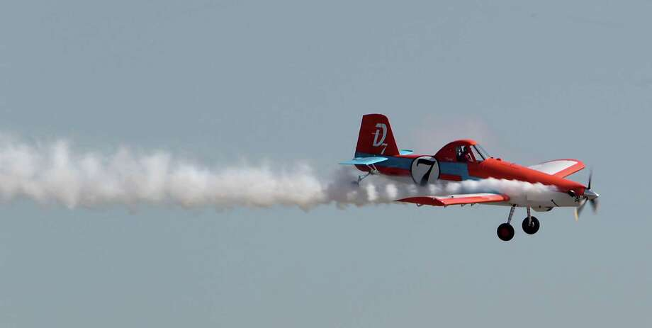 Disney's plane Dusty performs during the Wings Over Houston Airshow at Ellington Airport Saturday, Oct. 26, 2013, in Houston. Photo: James Nielsen, Houston Chronicle / © 2013  Houston Chronicle