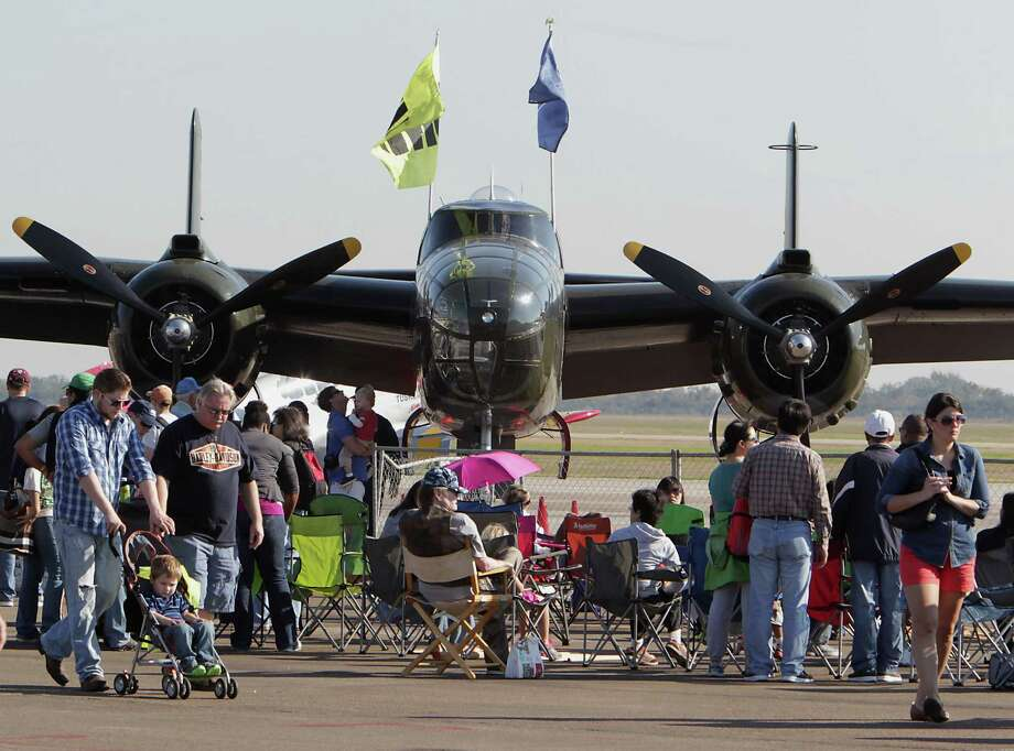 A B-25 airplane towers over the crowd during the Wings Over Houston Airshow at Ellington Airport Saturday, Oct. 26, 2013, in Houston. Photo: James Nielsen, Houston Chronicle / © 2013  Houston Chronicle