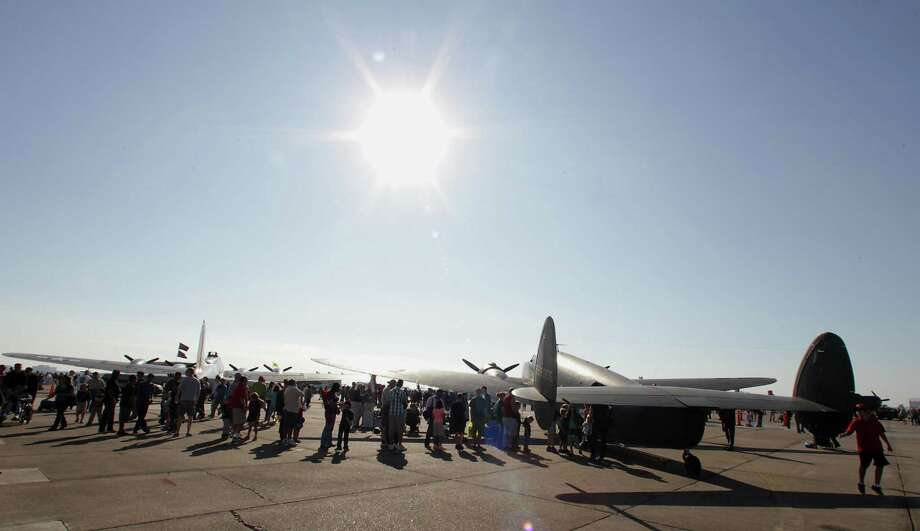 A line forms to tour a Lockheed C-60 airplane during the Wings Over Houston Airshow at Ellington Airport Saturday, Oct. 26, 2013, in Houston.   ( James Nielsen / Houston Photo: James Nielsen, Houston Chronicle / © 2013  Houston Chronicle