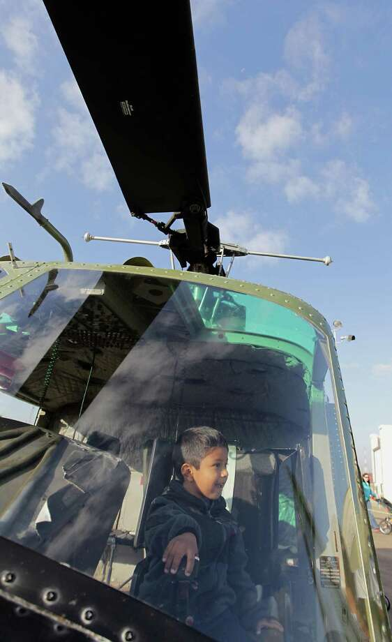 Four-year-old Zawl Reyes sits in the cockpit of a helicopter during the Wings Over Houston Airshow at Ellington Airport Saturday, Oct. 26, 2013, in Houston. Photo: James Nielsen, Houston Chronicle / © 2013  Houston Chronicle